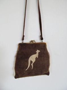 Australian Vintage Kangaroo Leather and Fur Purse- Tan, Cream, and Gold. $16.00, via Etsy.