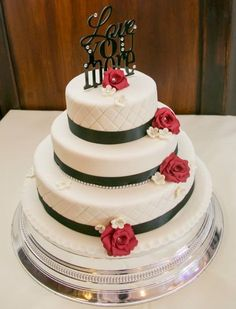 """Black, white and red simple wedding cake finished with """"Love you more"""" topper and red roses by Corr's Cakes"""