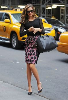 1f032f791d6a Miranda Kerr wore a Phillip Lim black sheer top with a Balenciaga patterned  pencil skirt and carried a Givenchy bag.