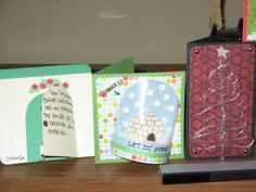 Christmas cards I made in 2010 (in some cases I cannot claim these ideas as original, though I'm not sure the sources). Yes, I did make a working snow globe with some large grained white glitter and some clear sheet plastic I had from some toy packaging!
