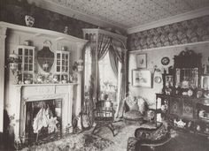 """Victorian drawing-room, 1890, with William Morris wallpaper and carpet."""