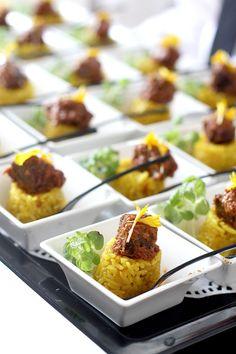 """Nasi Kuning"" (Indonesian yellow rice) topped with peanut sambal."