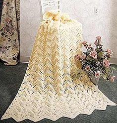 Crocheted Popcorn Ripple Afghan.  I've made several versions of these.  Solid colors, stripes and as a baby afghan.  Unless you use very light yarn, it's usually a heavy afghan.