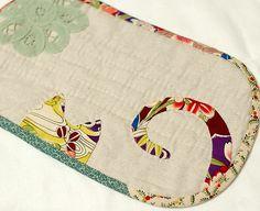 I like flower cat, mini quilt - mug mat idea???
