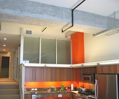Wall slide doors used in a #loft style #home can close off (or open up!) a room. Style seen here installed with smoked frosted glass and silver frame finish.  #interiordesign #design #decor #apartmentliving #beautiful #practical