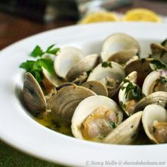 Clams in Wine and Garlic and Herb Broth. You know I've never cooked clams.