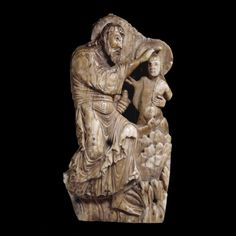 Fragment of an ivory panel showing the Baptism of Christ.  Anglo-Saxon, late 10th century AD. From southern England.