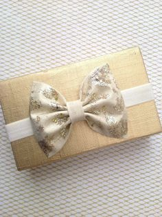 Gold glitter ivory fabric bow on ivory elastic baby by SplendidBee, $6.00