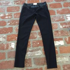 Artelier by Nicole Miller black pants Beautiful black pants with a little stretch.  From Nicole Millers more expensive line. Back pockets, front onset of pockets and waist made of faux looking leather material. Double eye hook and zipper front. From waist to top of inseam 7 inches. Inseam is 31 inches. Made in the USA. Artelier by Nicole Miller Pants Skinny