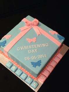Blue and pink christening cake - for boy and girl. Double layer dark and milk mud cakes with buttercream & fondant.