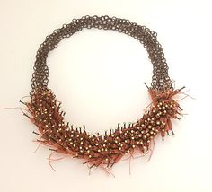 Evelien Sipkes Contemporary Jewelry Earthenware, Iron, Nails, Goldleaf, Linen.