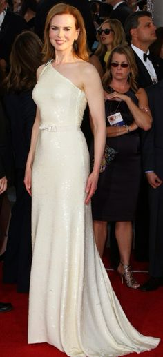 Nicole Kidman embellished her asymmetric Prada column with a turquoise Fred Leighton brooch at the Golden Globe Awards