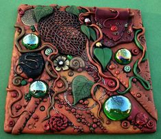 Finally finished this tile....it's been on my work table for months LOL! I love the lacey leaf I found, it was the inspiration for the rest of the tile I added an old cabochon I made and a pendant ...