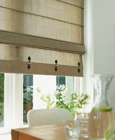 Embellish roman shades with faux-leather toggles for a utilitarian look.