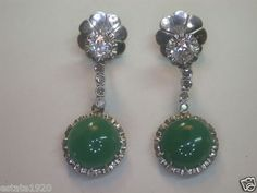 ANTIQUE ART DECO JADEITE & DIAMOND SCREW-BACK EARRINGS   {International Buyers Are Responsible For Customs & Duty Fee's}  CIRCA ~ 1920'S   2 ROUND CABOCHON JADEITE   SIZE ~ APPROXIMATELY 8 CARAT TOTAL WEIGHT  2 OLD MINE CUT DIAMONDS ~ .90 CARAT  COLOR ~ G - H  CLARITY ~ VS 2  8 SINGLE CUT DIAMONDS ~ .16 CARAT  COLOR ~ H - I  CLARITY ~ SI 1  TOTAL WEIGHT ~ 1.06 CARAT METAL ~ PLATINUM  WEIGHT ~ 8.7 GRAMS
