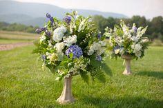 "wedding ceremony flowers at ""altar"""