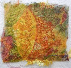 Created with a leaf skeleton, fabrics, free motion machine stitching and water soluble stabilizer.
