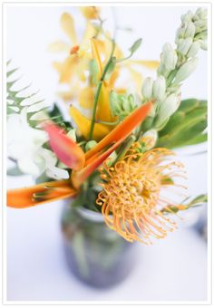 tropical floral in citrus colors Floral Wedding, Wedding Colors, Wedding Bouquets, Wedding Styles, Wedding Ideas, Tropical Centerpieces, Flower Centerpieces, Maui Weddings, Real Weddings