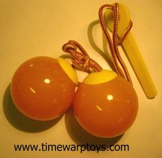 Used to play with these, want some.  Original Vintage OLD 1970s Lucite Clackers Klackers Klick-Klacks Toy  MINT Unused! on Etsy, $28.00