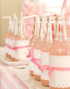 Think these would be really cute for a wedding with things written on them!  love gorgeous bottles made pretty with paper & ribbon