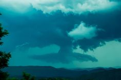 I shot this on a hike in the Blue Ridge Mountains in North Carolina 3 years ago. I could never get a definitive answer as to what this is...downdraft, formation of a tornado, collapsing cloud? We had gotten Tornado and severe thunderstorm warnings throughout that day.