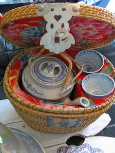 This is a vintage Chinese travel tea-for-two basket.