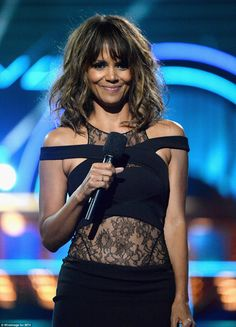 Lovely in lace: Halle rocked a very revealing number