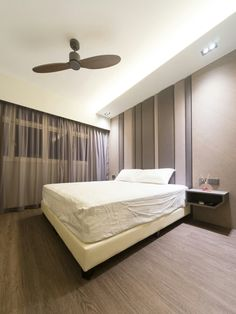 Master bedroom with cushion headhead feature wall. Vinyl flooring.   Modern interior concept, luxe, elegant feel. A project at Punggol, 5rm BTO HDB. - Samuel, Unity