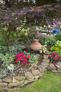 Shade Tree Lawn and Landscape | Pretty raised bed shaded garden, Japanese painted ferns, impatiens ... #LandscapingDIY
