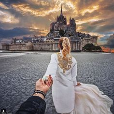 The couple also captured a dramatic picture on the beach at Mont-Saint-Michel in Normandy,...