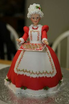 Claus Doll Cake (no link) I would use a Dolly Varden cake tin Christmas Cake Decorations, Christmas Cupcakes, Holiday Cakes, Christmas Treats, Christmas Desserts, Barbie Torte, Barbie Cake, Fondant Cakes, Cupcake Cakes
