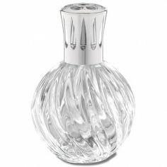 Lampe Torsadée transparente. Une lampe en verre transparent, au relief travaillé, toute en élégance et féminité.
