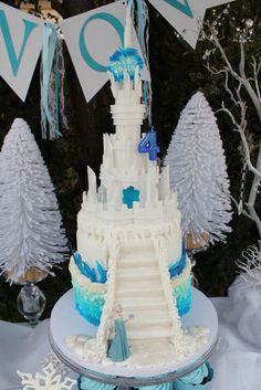 Frozen Winter Wonderland | CatchMyParty.com Frozen themed Birthday cake with Elsa and staircase.