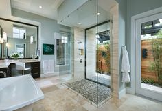 Amazing bathroom with free standing tub and open shower. See all the images from this professionally designed model home. Lakewood Ranch Luxury Designer Home Photo: http://arhomes.us/ravenna1291