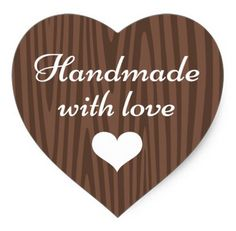 "Handmade sticker featuring white text ""handmade with love"" and a white heart on a dark wood background. Ideal for your handmade gifts"