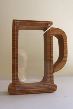 Who doesnt want a frosty beer mug shaped piggy bank? Perfect for the grownup whos not grown up! I would love to see this bank filled with pennies. This custom made piece is made of beautiful wood with 2 plexiglass sides and a small slit to insert the coins. It can be unscrewed on one side to get the change out. The top even has some yellow foam to make it that much more authentic. The bottom has the company, Creative Bankers, with their address and year of manufacturing, 1981. Perfect…