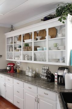 I LOVE the idea of open shelving instead of cabinets in the kitchen.  At least up top that is. Going back to the old kitchen designs of the 1900 - 1930's Just means a regular dust and clean and I like that you can enjoy beautiful pieces of crockery all the time.