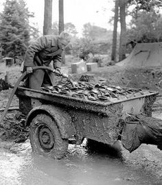 An American G. fills gas cans. Huertgen Forest, Nov 15 – Dec 3 1944 European Center of Military History) Ww2 History, Military History, 4th Infantry Division, Ww2 Weapons, D Day Landings, Sherman Tank, Bike Poster, Ww2 Photos, Ardennes