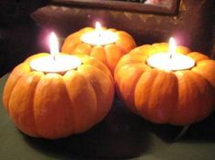 How adorable! Carve out holders into small autumn squashes and pumpkins to hold tealights!