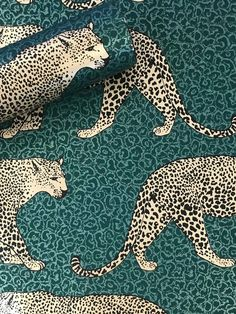 This stunning Leopard Wallpaper would make a unique and stylish feature in your home. The design features a repeat pattern of beautifully detailed leopards in metallic gold, set on a leopard print patterned background in tones of emerald green. Easy to apply, this high quality wallpaper has a beautiful metallic sheen finish and will look great when used to decorate a whole room or to create a feature wall. This colourway is exclusive to World of Wallpaper and can not be found on the high street. Leopard Wallpaper, Animal Print Wallpaper, Safari Animals, Cute Animals, Paper Wallpaper, Wallpaper Ideas, Wild Creatures, High Quality Wallpapers, Leopards
