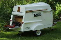 This tiny light fiberglass camper doubles as a boat. Its a mashup of a teardrop trailer, fiberglass camper, and a paddle boat.