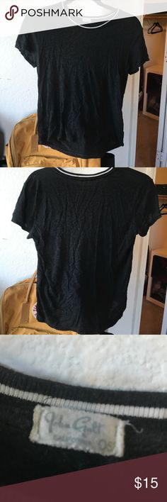 Black crop top with a white line on the neck Super cute crop top, and only wear twice. In great condition! Can fit any size Brandy Melville Tops Crop Tops