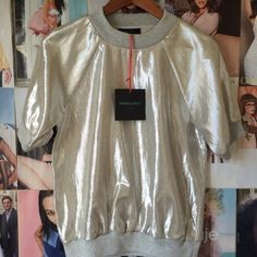 Cynthia Rowley Metallic Sweatshirt, silver This insanely chic sweatshirt is sold out everywhere--is it any wonder?! It can be worn alone, under a jacket or sweater or on top of a base layer. It is eye-catching and relaxed and exudes cool. It's tagged as a large, but could definitely fit a medium. This piece retailed at around $300. NWT. Cynthia Rowley Tops