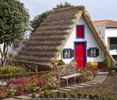 Traditional cottage from Santana, Madeira Island, Portugal is considered one of the 17 Beautiful Cottages You Wished You Lived In travelovertheglobe.com ' March 2015