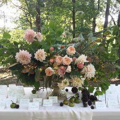 Escort-card table arrangement | Cafe au lait dahlias, Juliet garden roses, bittersweet branches, ranunculuses, persimmons