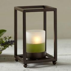 "Dramatic framework design on a smaller scale. Bronze-finished metal holder with frosted glass cup for use with votives and tealights, sold separately. 6""h, 3¾"" square. P91159"