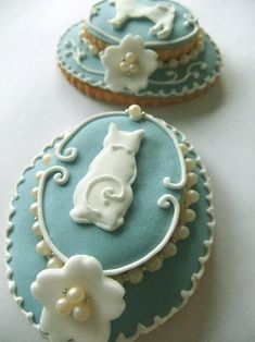 Cameo Brooch Icing Cookie #http://www.timelesstreasure.theaspenshops.com/product/amazing-bridal-shower-wedding-cookies.html