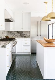 We get very excited about tile trends, and one of our favorite recent developments in the world of tile is a new look that's actually quite old: rectangular tiles laid in a herringbone pattern. We can't get enough of it, especially in the bathroom!