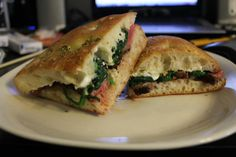 Medium-rare sirloin, blue cheese dressing, and sautéed spinach with garlic and red pepper flakes on rosemary-garlic focaccia - Imgur