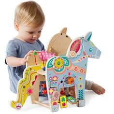 The Playful Pony activity toy from Manhattan Toy makes a great toddler birthday gift. This wooden Dala horse is non-toxic and and made of natural wood. Toddler Toys, Toddler Activities, Baby Toys, Toddler Birthday Gifts, First Birthday Gifts, Birthday Ideas, Activity Toys, Activity Centers, Manhattan
